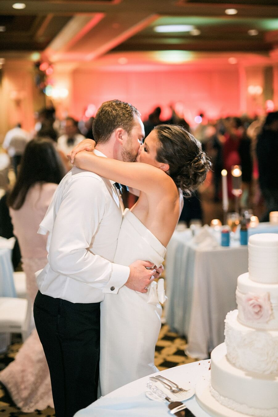 Bride and groom kissing at Wiley Entertainment wedding reception