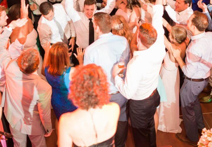People dancing at wedding reception hosted by Wiley Entertainment