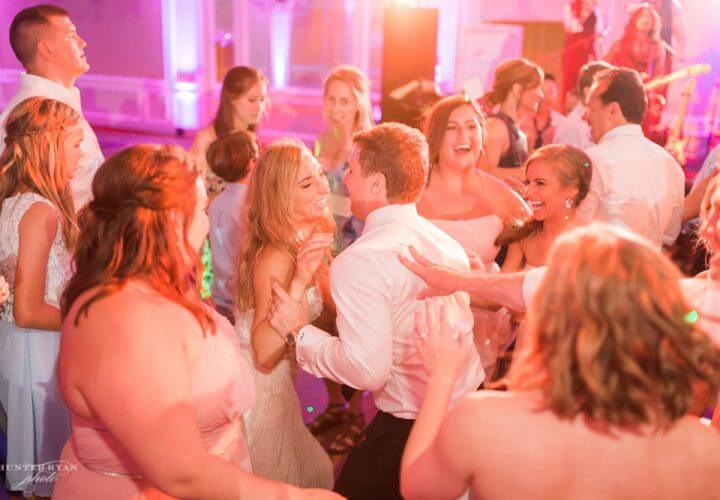 Bride and groom dancing at Wiley Entertainment hosted wedding reception