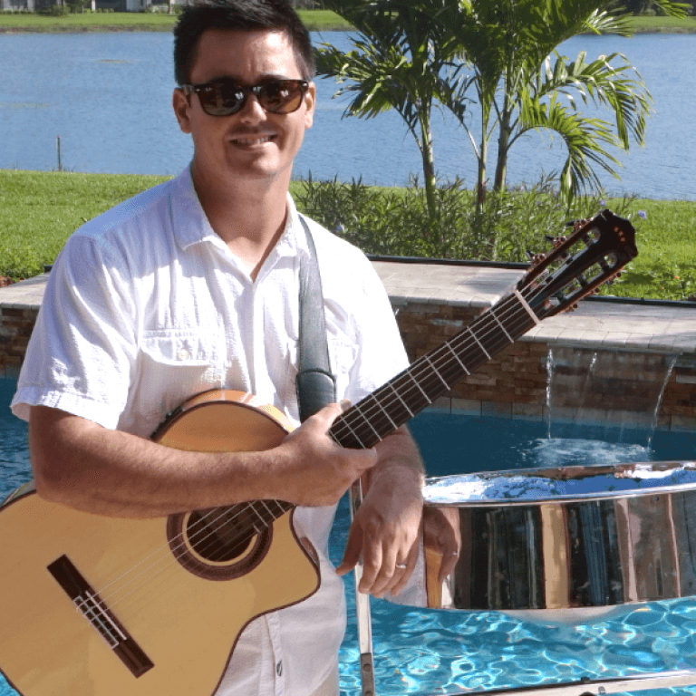 Live guitar and steel drum by played Jim Gable