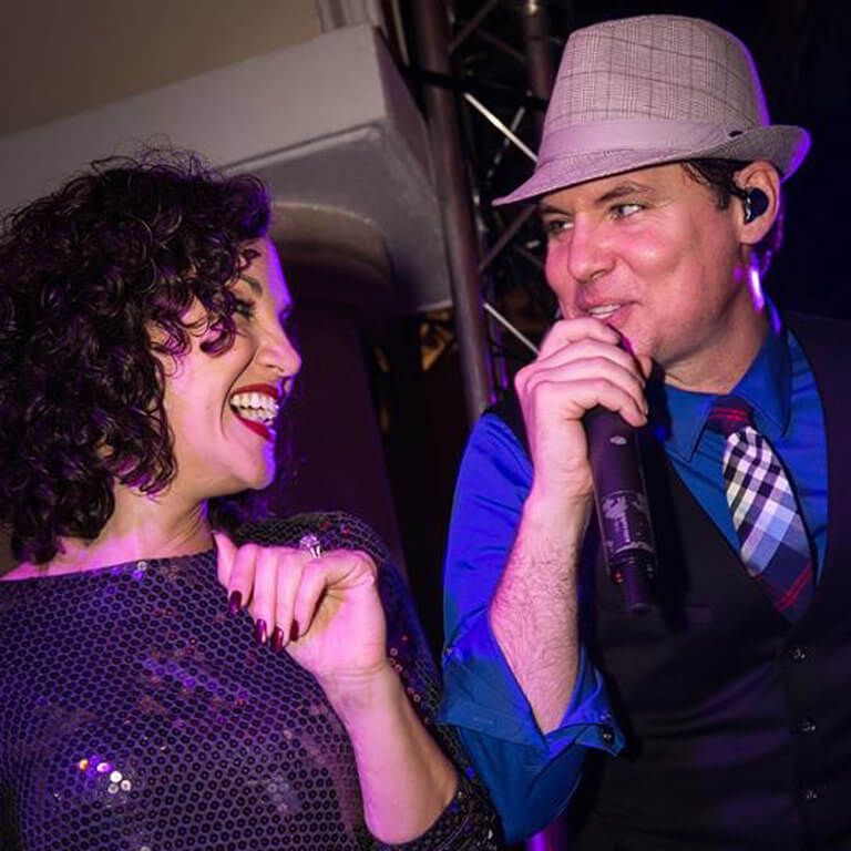 Lyli and Clint of Wiley Entertainment performing for corporate event
